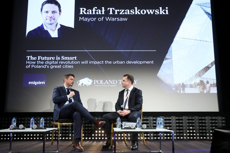 The Mayor of Warsaw, Rafał Trzaskowski, talks with Richard Stephens, editor of Poland Today during MIPIM 2019
